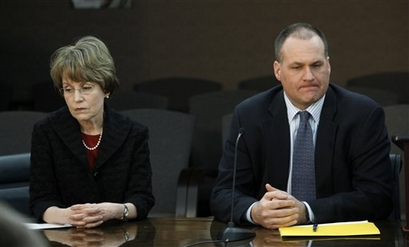 University of Michigan President Mary Sue Coleman, left, and head football coach <strong>Rich Rodriguez</strong>, right, are shown at a news conference in Ann Arbor, Mich., Tuesday, Feb. 23, 2010. The NCAA has found that Michigan's storied football program was out of compliance with practice time rules under coach Rodriguez. Incoming athletic director David Brandon disclosed the finding Tuesday. He says there were no surprises in the NCAA findings. He also says Rodriguez remains the coach. Michigan has 90 days to respond and will appear at an NCAA hearing on infractions in August. photo appears courtesy of  Associated Press/ Paul Sancya  ......