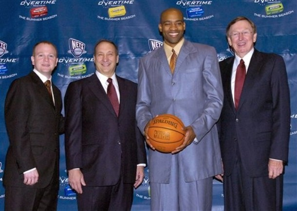 New Jersey Nets coach Lawrence Frank, left, owner Bruce Ratner, and president Rod Thorn, right, pose with Vince Carter at a news conference after Carter signed a new multi-year contract with the basketball team Friday, July 13, 2007 in East Rutherford, N.J. photo  appears  courtesy of  Associated  Press/  Bill  Kostroun  ...........