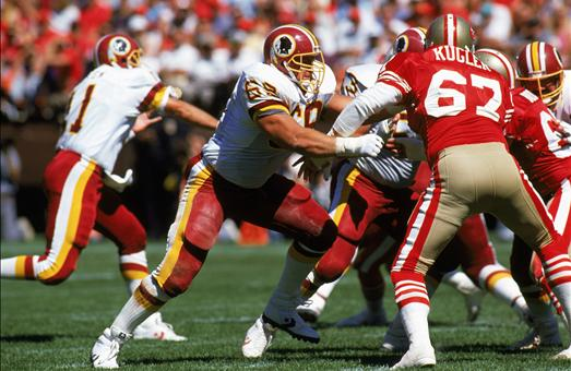 """An anchor on three Super Bowl champions for the Washington Redskins, <strong>Russ Grimm <em>(left foreground)</em></strong>, one of the """"Hogs,"""" was a four-time Pro Bowler at guard. A member of the 1980s all-decade team, Grimm was part of a unit that helped the Redskins average 152 rushing yards a game in the 1982 postseason en route to a win in Super Bowl XVII.  photo  appears  courtesy  of   Associated  Press/   Mark  Talbot  ..........."""
