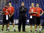 Oklahoma's Sam Bradford, center, watches drills between fellow quarterbacks, left to right, Appalachian State's Armanti Edwards, Western Michigan's Tim Hiller, Northwestern's Mike Kafka, and Troy's Levi Brown at the NFL football scouting combine in Indianapolis, Sunday, Feb. 28, 2010.