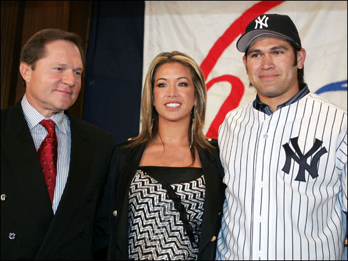 Scott Boras   with  client  Johnny   Damon   and    Damon's  wife  Michelle