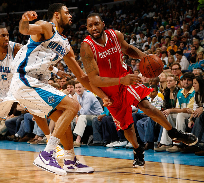 <strong> Tracy McGrady (#1)</strong> of the Houston Rockets drives the ball around Tyson Chandler (#6) of the New Orleans Hornets on December 26, 2008 at the New Orleans Arena in New Orleans, Louisiana. According to reports on February 18, 2010, McGrady was traded to the New York Knicks in a three team trade between the Houston Rockets, Sacramento Knigs, and Knicks.  photo appears courtesy  of  Getty  Images/  Chris  Graythern .................