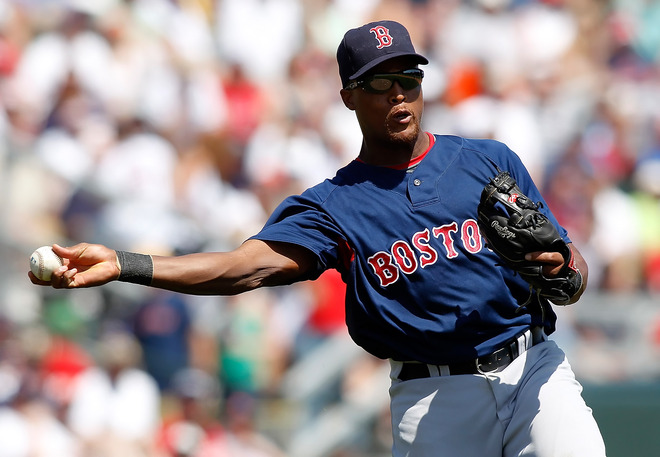 Sarasoata , Fl ,.  Infielder Adrian Beltre (29) of the Boston Red Sox  throws over to first for an out against the Baltimore Orioles during a Grapefruit League Spring Training Game at Ed Smith Stadium on March 27, 2010 in Sarasota, Florida. photo  appears  courtesy  of Getty  Images/  J  Meric  ..........