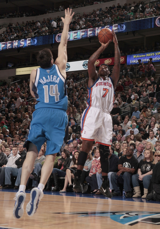 Al Harrington (7) of the New York Knicks shoots a jumper against Eduardo Najera (14) of the Dallas Mavericks during a game at the American Airlines Center on March 13, 2010 in Dallas, Texas.  photo  appears  courtesy  of NBAE/ Getty Images/  Danny   Bollinger  ............