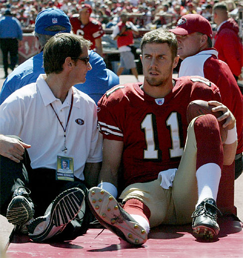 Alex  Smith the  San  Francisco  49ers   starting  quarterback  sits  on  the  sidelines  during  an  NFL game  having  sustained   a leg   injury.  photo  appears courtesy  of   Cary  Edmondson /US Presswire  .........................