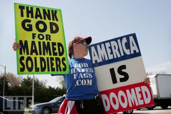 Anti-Gay Activists Continue Protests At War Funerals MAYWOOD, IL - APRIL 19: Shirley Phelps-Roper, a member of Westboro Baptist Church of Topeka, Kansas, protests across the street from the Edward Hines Jr. VA Hospital April 19, 2006 in Maywood, Illinois. Members of the church are known for their protest outside military funerals but as many states have drafted laws limiting access near funerals they have begun to focus on Veteran's hospitals as a means of getting their anti-gay message heard.