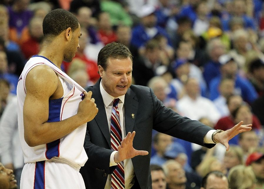 KANSAS CITY, MO - MARCH 13: Head coach Bill Self of the Kansas Jayhawks instructs Xavier Henry #1 during the 2010 Phillips 66 Big 12 Men's Basketball Championship agaisnt the Kansas State Wildcats on March 13, 2010 at the Sprint Center in Kansas City, Missouri