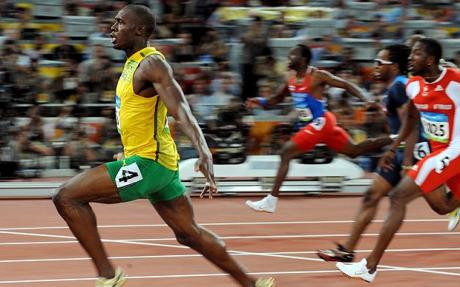 Bolt wins   gold in the  100 meters   going   away   from  his   fellow  competitors   in   Beijing  in  a  world  record  time of   9.69 .    photo   appears  courtesy  of  Reuters/   David   Duscherre  ...............