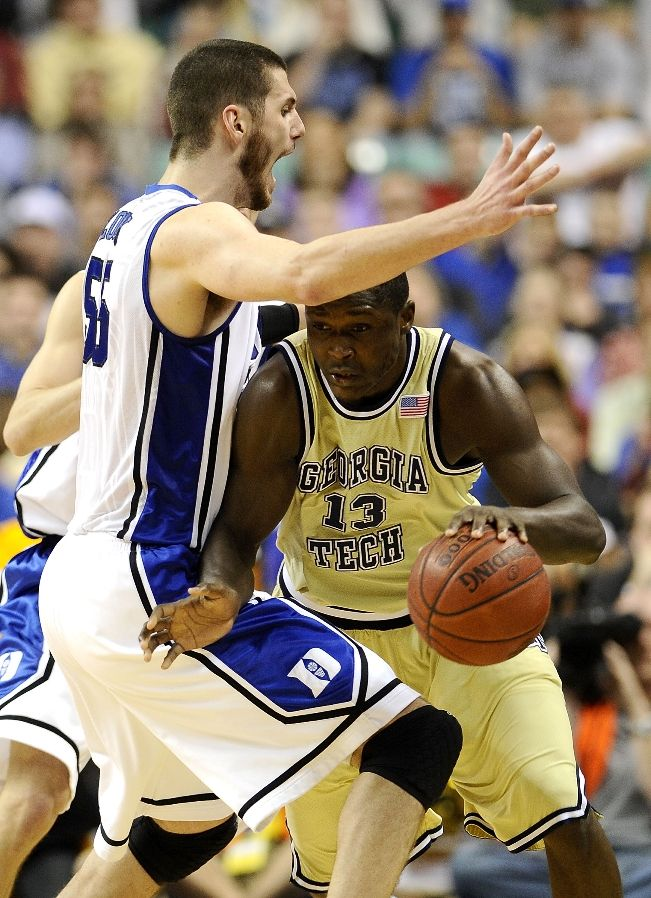 GREENSBORO, NC - MARCH 14: Brian Zoubek #55 of the Duke Blue Devils guards D'Andre Bell #13 of the Georgia Tech Yellow Jackets in the championship game of the 2010 ACC Men's Basketball Tournament at the Greensboro Coliseum on March 14, 2010 in Greensboro, North Carolina.