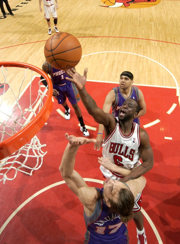 Ronald Murray (6) of the Chicago Bulls lays the ball up and over Louis Amundson (17) of the Phoenix Suns, as Jared Dudley #3 of the Suns watches from behind  during a NBA game on March 30, 2010 at the United Center in Chicago, Illinois.  photo appears courtesy  of  NBAE/Getty Images / Randy  Belice  ......