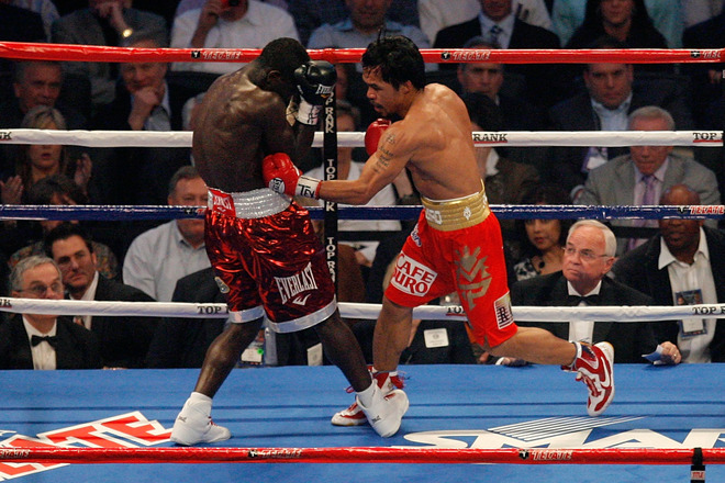 Arlington , Tx  (R-L) Manny Pacquiao of the Philippines throws a left to the body of Joshua Clottey of Ghana during the WBO welterweight title fight at Cowboys Stadium on March 13, 2010 in Arlington, Texas. Pacquiao defeated Clottey by unanimous decision. photo  appears  courtesy of  Getty Images/ Tom Pennington .............