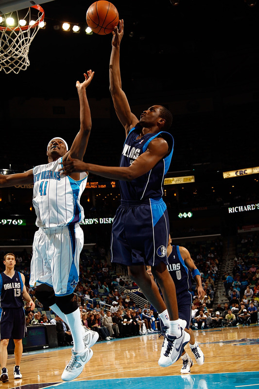 New Orleans, La,. Rodrigue Beaubois (3) of the Dallas Mavericks shoots the ball over James Posey (41) of the New Orleans Hornets at the New Orleans Arena on March 22, 2010 in New Orleans, Louisiana.  The Hornets defeated the Mavericks 115-99.  photo appears courtesy  of  Getty Images/  Chris  Graythern  ..............