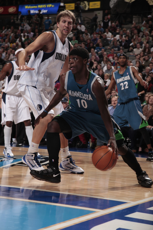 Jonny Flynn (#10) of the Minnesota Timberwolves drives the baseline against Dirk Nowitzki (#41) of the Dallas Mavericks during a game at the American Airlines Center on March 3, 2010 in Dallas, Texas. photo appears  courtesy of  NBAE/ Getty Images/ Danny  Bollinger  ..........