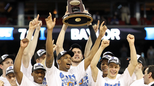 The Duke Blue Devils hold up the trophy after a 78-71 win over the Baylor Bears in the south regional final of the NCAA men's basketball tournament at Reliant Stadium in Houston on Sunday. photo appears  courtesy of  Getty  Images/  Ronald  Martinez  ...