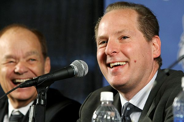 T'wolves' GM David Kahn (foreground)and the team's owner Glen Taylor (left) answer questions from the convened press at a team press conference. picture appears courtesy of espn.com/ ap/photo/ Martin Geshell ...................