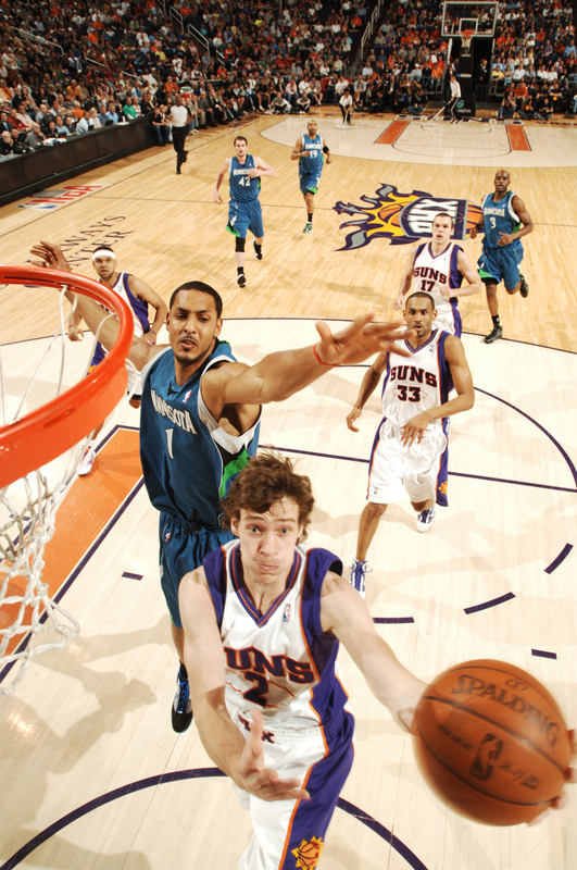 Goran Dragic (2) of the Phoenix Suns drives for a shot past Ryan Hollins (1) of the Minnesota Timberwolves in an NBA Game played on March 16, 2010 at U.S. Airways Center in Phoenix, Arizona. photo appears  courtesy of  NBAE/ Getty  Images/  Barry  Gossage  ......................