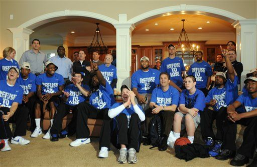 University of Kentucky basketball coach coach John Calipari watches the NCAA tournament selection show with the team at his home Sunday, March 14, 2010 in Lexington, Ky. Kentucky was named the top seed in the East region of the NCAA tournament and will face E. Tennessee State Thursday in New Orleans