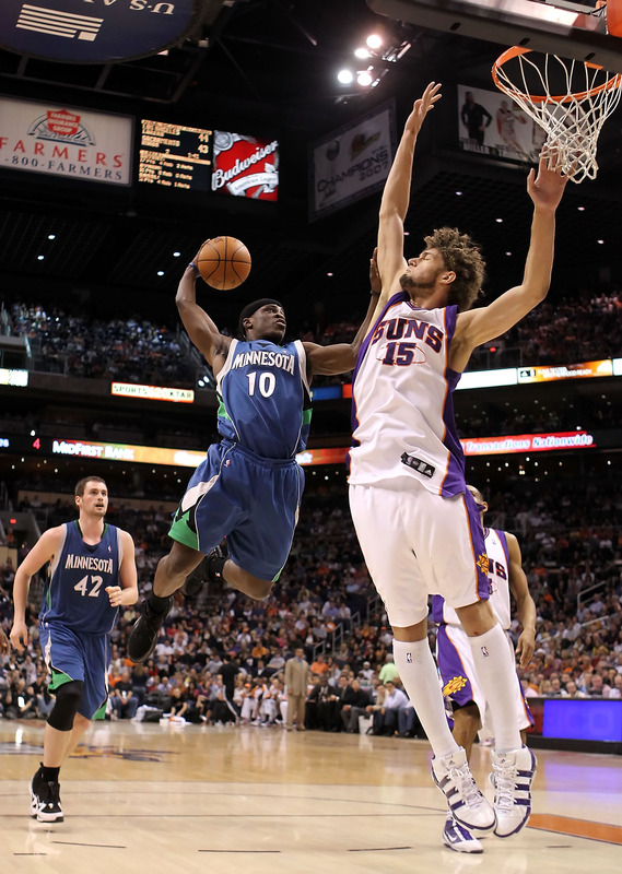 Jonny Flynn (10) of the Minnesota Timberwolves drives to the basket against Robin Lopez (15) of the Phoenix Suns during the NBA game at US Airways Center on March 16, 2010 in Phoenix, Arizona. The Suns defeated the Timberwolves 152-114.   photo appears  courtesy  of  Getty  Images/  Christian  Petersen ....