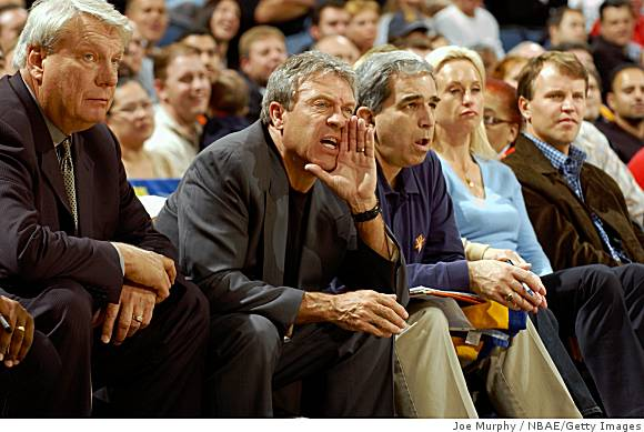 Warriors' coach   Don  Nelson  seated   next  to   team  GM Larry Riley  at    Warriors  game played   at  Oracle  Arena  ,  Oakland ,  California .   photo appears  courtesy  of  Getty  Images/  Joe  Murphy  ...............