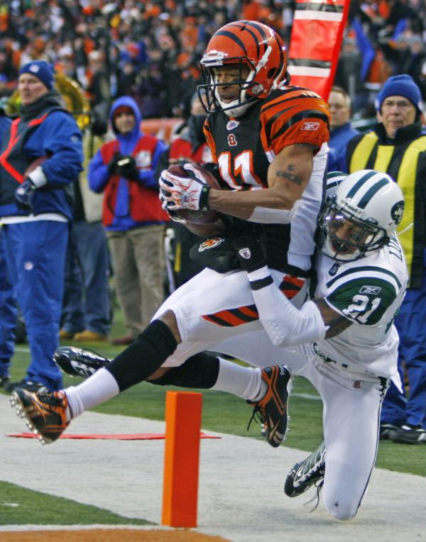 Cincinnati Bengals receiver Laveraneus Coles (11) catches an 11-yard touchdown pass against New York Jets cornerback Dwight Lowery (21) in the first half of an NFL wild-card playoff football game, Saturday, Jan. 9, 2010, in Cincinnati.