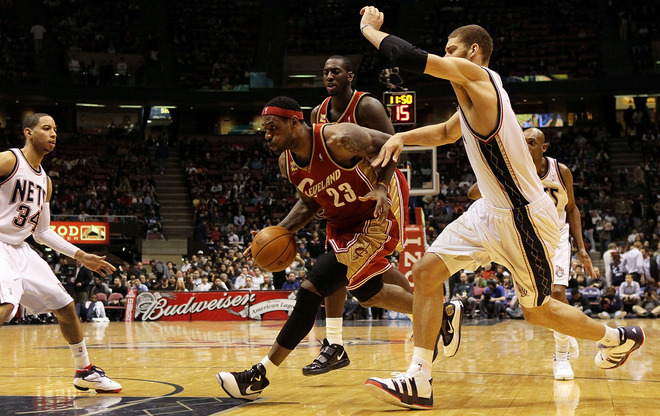 East Rutherford March 3rd 2010. LeBron James (#23) of the Cleveland Cavaliers controls the ball against the New Jersey Nets at the Izod Center in East Rutherford, New Jersey. photo appears  courtesy  of  Getty Images / Jim  McIsaacs ........