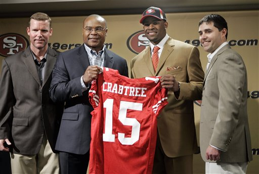 Michael Crabtree, center right, the San Francisco 49ers' first-round pick in the NFL football draft, holds up his new jersey number as he stands with 49ers coach Mike Singletary, center left, general manager Scot McCloughan, left, and president Jed York, right, during a news conference in Santa Clara, Calif., Sunday, April 26, 2009. Crabtree is a wide receiver from Texas Tech. photo  appears  courtesy  of   Associated  Press/ Paul   Sakuma  ................