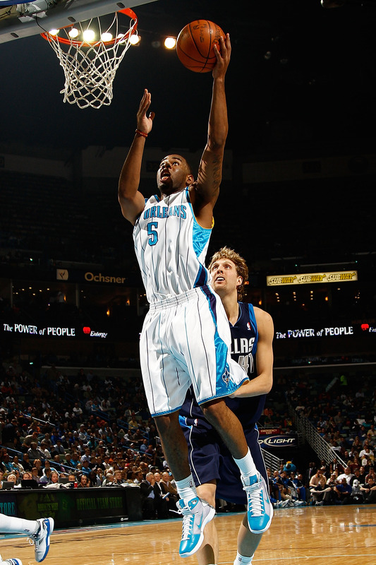Marcus Thornton (5) of the New Orleans Hornets shoots the ball over Dirk Nowitzki (41) of the Dallas Mavericks at the New Orleans Arena on March 22, 2010 in New Orleans, Louisiana. photo  appears  courtesy  of Getty Images/  Chris  Graythern  ........