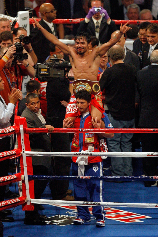 Manny Pacquiao of the Philippines celebrates in the ring after defeating Joshua Clottey of Ghana during the WBO welterweight title fight at Cowboys Stadium on March 13, 2010 in Arlington, Texas. Pacquiao defeated Clottey by unanimous decision.  photo appears  courtesy  of   Getty  Images/ Tom Pennington  .......