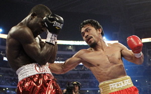 Manny Pacquiao, right, of the Philippines, hits Joshua Clottey, from Ghana, during their WBO boxing welterweight title fight in Cowboys Stadium in Arlington, Texas, Saturday, March 13, 2010. photo appears  courtesy  of  Associated  Press  / David J Phillip ..............