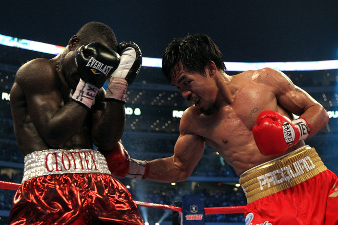 Manny Pacquiao of the Philippines throws a right to the body of Joshua Clottey of Ghana during the WBO welterweight title fight at Cowboys Stadium on March 13, 2010 in Arlington, Texas. Pacquiao defeated Clottey by unanimous decision.  photo  appears  courtesy of  Getty  Images/ Jed  Jacobsohn ......