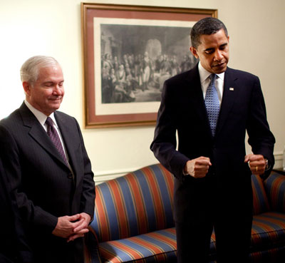 President  Barack Obama  is   seen  here  with  Defense  Secretary   Robert  Gates .   The  two   are  at  odds   with  senior members  of   the  military   and  some  conservatives   within  their   respective  political  parties as  to  whether  or  not  the  military's <strong> 'don't  ask   don't   tell  policy' </strong></em>   ought  to  be   re-enacted.     photo  appears  courtesy  of  telegraph.co.uk       copyrighted  material .....   @ all  rights  reserved