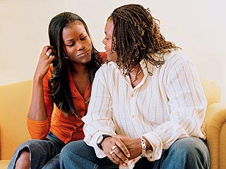 Former   WNBA  star   Sheryl  Swoopes  and  her  partner  Alisia  Scott  .   The  two  women   co-share   the custody   of   Swoopes'  children  with  Sheryl's   ex-husband.    Swoopes   an   advocate   for  gay  causes  now  spends  much  of  her   time lecturing   up  and   down  the  country  as  well  as  working  in  conjunction   with   GLAAD. (Gay & Lesbian Alliance   Against  Defamation)    .  photo  appears   courtesy of   watermark / Elizabeth    Walsh ..............