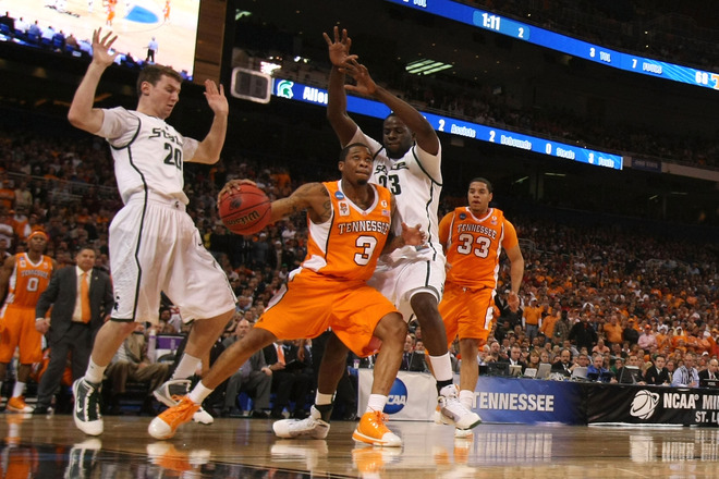 St. Louis , Bobby Maze (3) of the Tennessee Volunteers looks to shoot the ball against Mike Kebler (20) and Draymond Green (23) both of the Michigan State Spartans during the midwest regional final of the 2010 NCAA men's basketball tournament at the Edward Jones Dome on March 28, 2010 in St. Louis, Missouri. Michigan State beat Tennessee 70-69. photo appears courtesy of Getty Images/ Dilip Vishwanat ...