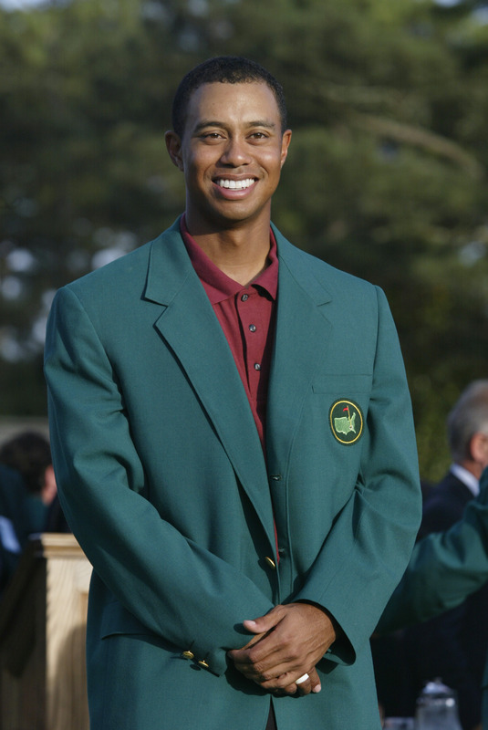 Augusta ,Ga,. Tiger Woods is awarded the green jacket after winning the Masters Tournament at the Augusta National Golf Club on April 14 , 2002 in Augusta, Georgia. Woods announced March 16, 2010 that he plans to play in April at the Masters. photo appears courtesy of Getty Images/ Andrew Reddington ..........