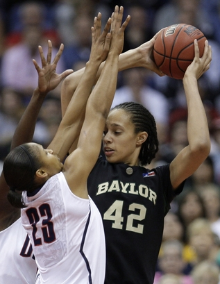 Baylor's   Brittney  Griner  and   U Conn's  Maya  Moore  are  seen  here   during  the  women's   Final  Four   game   between the two  teams.  Geno  Auriemma's   Huskies  would   go  on  to  defeat  the  Baylor Lady  Bears    <u> 70-50</u>  in  the   game  played  at the  Alamodome in   San  Antonio  ,  Texas , Sunday  April 4th  2010.   photo appears  courtesy  of  Getty  Images/   Alicia  Mack  ...........
