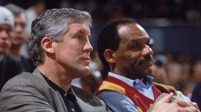 Carroll (left) is seen here at a college basketball along with USC Athletics Director Mike Garrett game at Galen Arena , home to the USC Trojans men's baskeball team . The $200 million venue was joint fund raising effort initiated by Garrett in conjunction with boosters , alumni and local businesses within the greater Los Angeles area. photo appears courtesy of Getty Images North America / Rafael Dominguez ............
