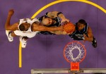 Andrew Bynum of the Lakers contests a loose ball with the Jazz' Carlos Boozer (center) and C J Miles. Getty Images/ Stephen Dunn ......