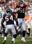 Linebacker Brian Cushing #56 of the Houston Texans intercepts a pass intended for Ricky Williams #34 of the Miami Dolphins at Land Shark Stadium on December 27, 2009 in Miami, Florida. Getty Images / Doug Benc ............