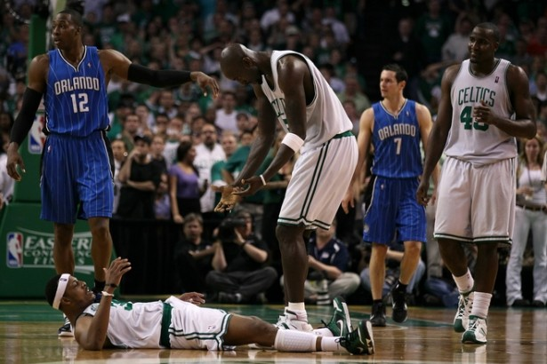 Kevin Garnett (5) of the Boston Celtics helps Paul Pierce (34) up against the Orlando Magic in Game Six of the Eastern Conference Finals during the 2010 NBA Playoffs at TD Garden on May 28, 2010 in Boston, Massachusetts. Getty Images/ Elsa Martinez