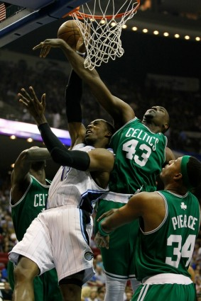 Dwight Howard (12) of the Orlando Magic draws contact as he attempts a shot against Kendrick Perkins (43) and Paul Pierce (34) of the Boston Celtics in Game Two of the Eastern Conference Finals during the 2010 NBA Playoffs at Amway Arena on May 18, 2010 in Orlando, Florida. Getty Images/ Kevin C Cox .........