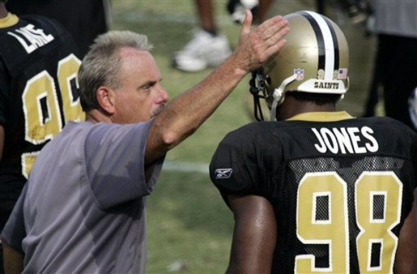 New Orleans Saints linebacker coach Joe Vitt, left, gives linebacker Dhani Jones (98) a congratulatory tap on his helmet after a successful play at the afternoon summer preseason football practice at the Mississippi Veterans Memorial Stadium, Tuesday, July 31, 2007, in Jackson, Miss. Associated Press _ Michael Russo