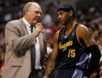 Karl is seen here with Nuggets' player Carmelo Anthony during an NBA game. The two have formed a very close relationship between player and coach. Getty Images/ Neil Broadhurst