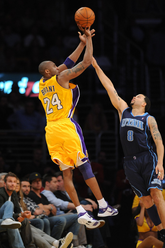 "<font face=""andalus"" size=""3"">  Kobe Bryant (24) of the Los Angeles Lakers shoots against Deron Williams (8 )of the Utah Jazz in Game Two of the Western Conference Semifinals during the 2010 NBA Playoffs at Staples Center on May 4, 2010 in Los Angeles, California. NBAE Getty Images/  Noah Graham  </font>"
