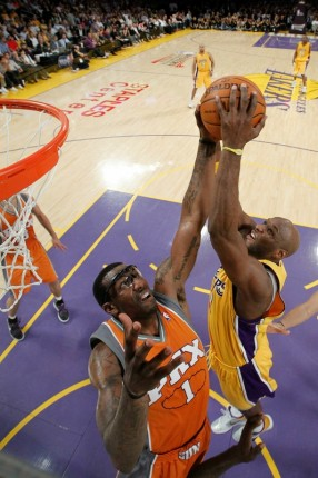 Lamar Odom (7) of the Los Angeles Lakers has his shot blocked by Amar'e Stoudemire (1) of the Phoenix Suns in the second half of Game Two of the Western Conference Finals during the 2010 NBA Playoffs at Staples Center on May 19, 2010 in Los Angeles, California. Images License Agreement. Photo by Wally Skalij/Getty Images...........