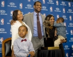 Cleveland Cavaliers forward and NBA Most Valuable Player LeBron James, center, stands with his family, girfriend, Savannah Brinson, left, in white, son, LeBron Jr., foreground left, James mother Gloria, right, holding James son Bryce, after the NBA MVP award ceremony for James on the University of Akron campus in Akron, Ohio, Sunday, May 2, 2010. AP Photo/ Phil Long ...........