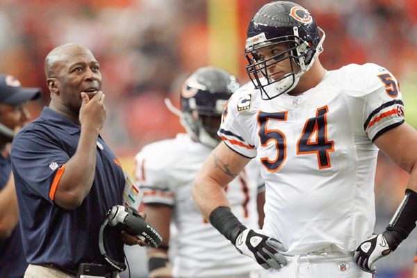 Bears' coach Lovie Smith is seen here on the sidelines with Brian Urlacher during an NFL game . Getty Images/ Ross Nicholls ..............