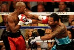 Mayweather lands a left to the jaw of Mosley during their bout. Getty Images/ Ethan Miller ............