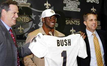 The Saints' newest player, Reggie Bush, holds up a jersey with Saints general manger Mickey Loomis, left, and coach Sean Payton at the club's headquarters in Metairie, La., on Saturday. The Saints had the second pick overall in the NFL Draft and they took Bush. The player was the team's number one overall pick in the 2006 NFL Draft Associated Press / Alex Brandon ............