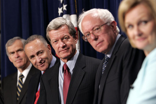 Senate Finance Committee Chairman Sen. Max Baucus, D-Mont., center, accompanied by fellow Senate Democrats, listens to a reporter's question during a news conference on Capitol Hill in Washington. From left are, Sen. Jeff Bingaman, D-N.M.; Sen. Charles Schumer, D-N.Y.; Baucus; Sen. Bernard Sanders, I-Vt., and Sen. Claire McCaskill, D-Mo. Associated Press / Susan Walsh ................