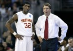 O.J. Mayo (left) talks with his head coach Tim Floyd (right) of the USC Trojans during their first round NCAA men's basketball championship game in Omaha, Nebraska March 20, 2008. Reuters / Jeff Haynes ............